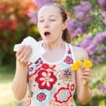spring sneezing girl Seasonal allergies Kris Shaw